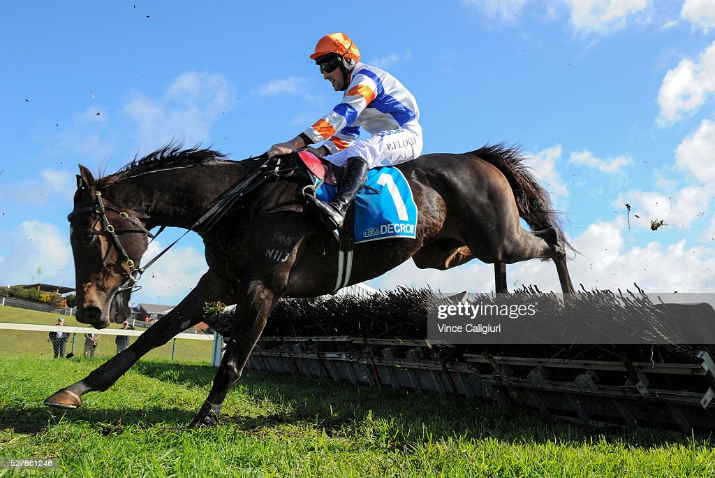 Patrick Flood riding Banksters Bonus jumps the last hurdle during unplaced run in Race 1, the Decron Maiden Hurdle during Brierly Day at Warrnambool Race Club on May 4, 2016 in Warrnambool, Australia.