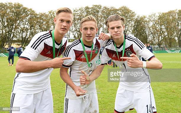 Patrick Fritsch Felix Passlack and Dzenis Burnic of Germany pose withe the KOMM MIT cup after their victory in the KOMM MIT tournament match between...