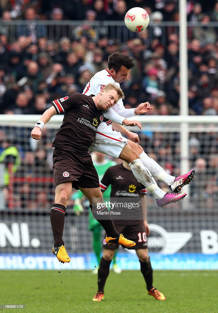 Patrick Fuknk (front) of St. Pauli and Andre Fomitschow (back) of Cottbus head for the ball during the second Bundesliga match between FC St. Pauli and Energie Cottbus at Millerntor Stadium at Millerntor Stadium on February 3, 2013 in Hamburg, Germany.