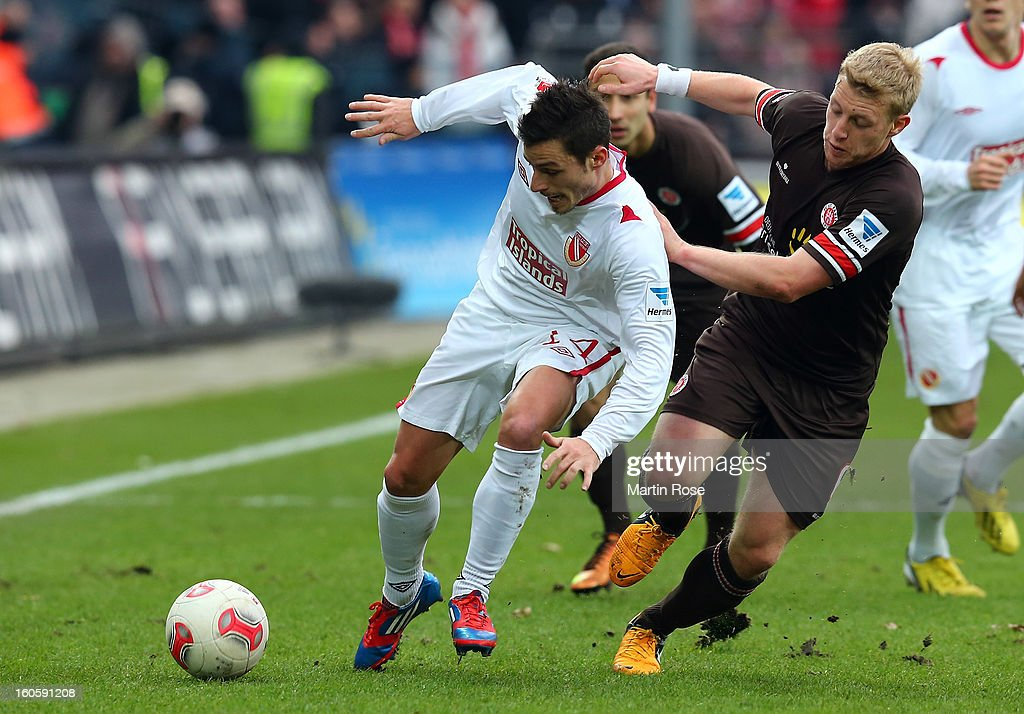 Patrick Funk (R) of St. Pauli and Nicolas Farina (L) of Cottbus battle for the ball during the second Bundesliga match between FC St. Pauli and Energie Cottbus at Millerntor Stadium at Millerntor Stadium on February 3, 2013 in Hamburg, Germany.