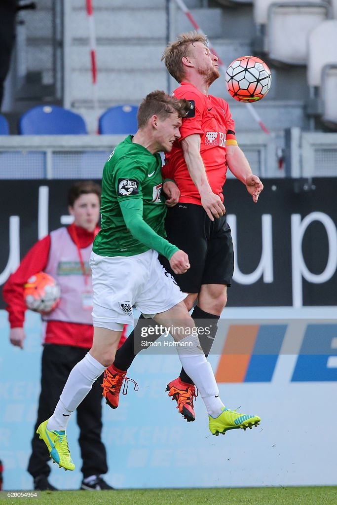 <a gi-track='captionPersonalityLinkClicked' href=/galleries/search?phrase=Patrick+Funk&family=editorial&specificpeople=691617 ng-click='$event.stopPropagation()'>Patrick Funk</a> of Wiesbaden jumps for a header with Felix Mueller of Muenster during the Third League match between Wehen Wiesbaden and Preussen Muenster at BRITA-Arena on April 29, 2016 in Wiesbaden, Hesse.