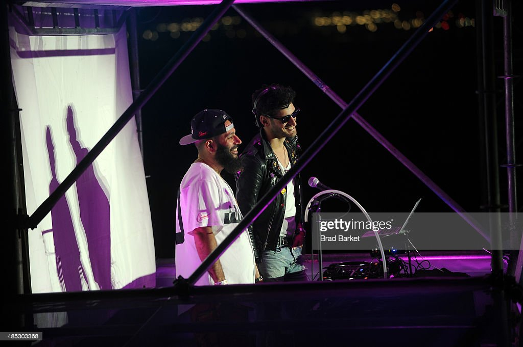 Patrick Gemayel and David Macklovitch of Chromeo spin at Rally On The River presented by American Express, featuring Maria Sharapova, John Isner, Monica Puig and DJ Set By CHROMEO at Pier 97 on August 26, 2015 in New York City.