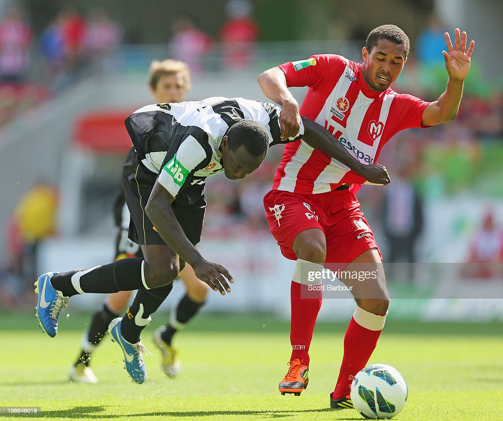 Patrick Gerhardt of the Heart and Emile Heskey of the Jets compete for the ball during the round 14 ALeague match between Melbourne Heart and the...