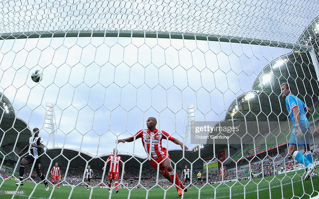 Patrick Gerhardt of the Heart and goalkeepeer Clint Bolton can only watch as a shot from Craig Goodwin (out of frame) of the Jets floats into the goal during the round eight A-League match between the Melbourne Heart and the Newcastle Jets at AAMI Park on November 24, 2012 in Melbourne, Australia.