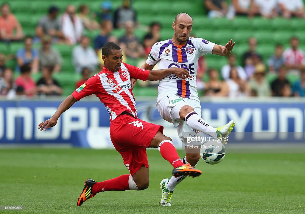 Patrick Gerhardt of the Heart challenges Billy Mehmet of the Glory during the round 10 A-League match between the Melbourne Heart and the Perth Glory at AAMI Park on December 8, 2012 in Melbourne, Australia.