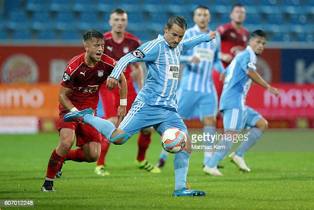 Patrick Goebel of Zwickau battles for the ball with Anton Fink of Chemnitz during the third league match between Chemnitzer FC and FSV Zwickau at...