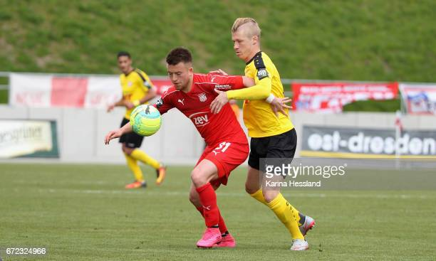 Patrick Goebel of Zwickau is challenged by Michael Kessel of Koeln during the Third League match between FSV Zwickau and Fortuna Koeln on April 23...
