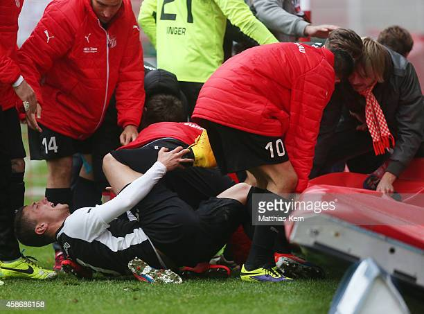 Patrick Grandner of Zwickau is injured after team mates celebrate with their supporters after the Regionalliga Nordost match between 1FC Union Berlin...