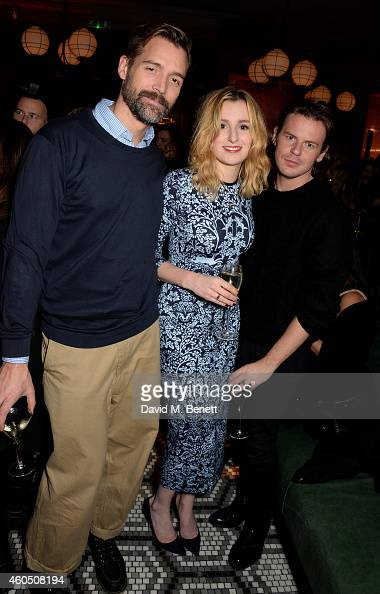 Patrick Grant actress Laura Carmichael and Christopher Kane attend the LOVE x Balmain Xmas Party at The Ivy Market Grill on December 15 2014 in...