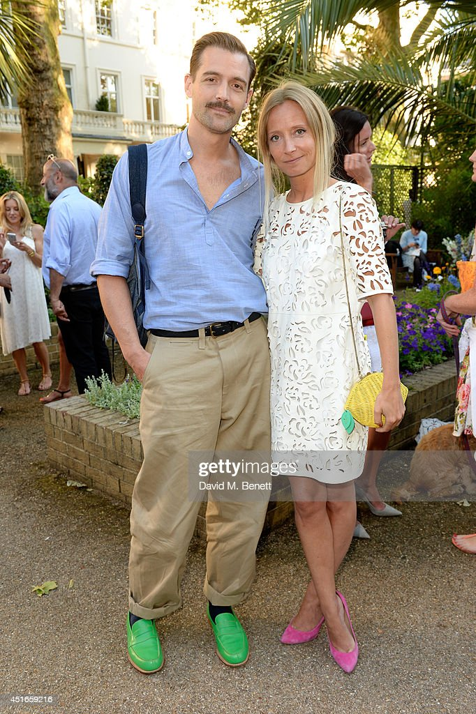 Patrick Grant and <a gi-track='captionPersonalityLinkClicked' href=/galleries/search?phrase=Martha+Ward&family=editorial&specificpeople=4263200 ng-click='$event.stopPropagation()'>Martha Ward</a> attend the Club Monaco Garden Party hosted by Quentin Jones, Clara Paget and Annie Morris in Eaton Square on July 3, 2014 in London, England.