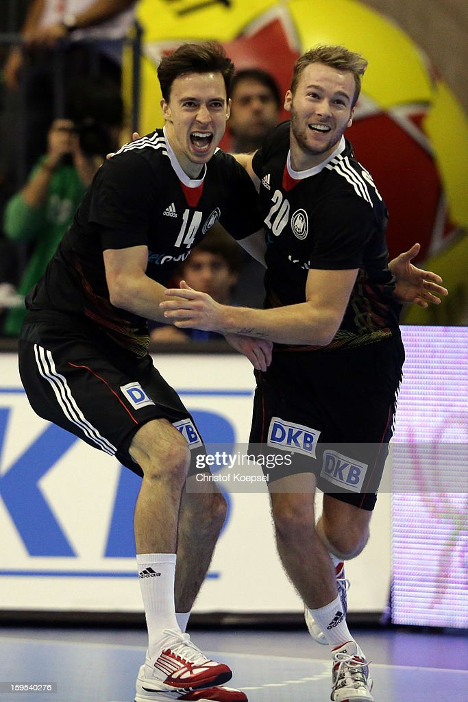 Patrick Groetzki and Kevin Schmidt of Germany celebrate during the premilary group A match between Germany and Argentina at Palacio de Deportes de Granollers on January 15, 2013 in Granollers, Spain. The match betwwen germany and Argentina ended 31-27.