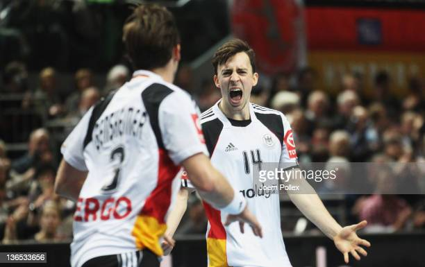 Patrick Groetzki and Uwe Gensheimer of Germany celebrate during the International handball friendly match between Germany and Hungary at OeVB Arena...
