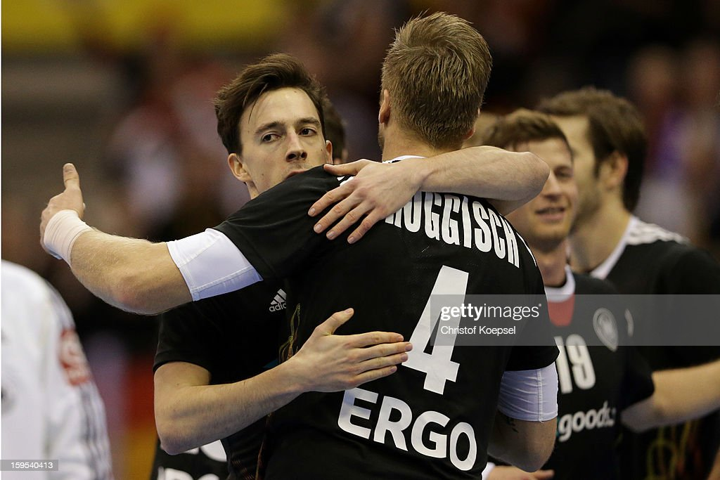 Patrick Groetzki embraces <a gi-track='captionPersonalityLinkClicked' href=/galleries/search?phrase=Oliver+Roggisch&family=editorial&specificpeople=577212 ng-click='$event.stopPropagation()'>Oliver Roggisch</a> of Germany during the premilary group A match between Germany and Argentina at Palacio de Deportes de Granollers on January 15, 2013 in Granollers, Spain. The match betwwen germany and Argentina ended 31-27.