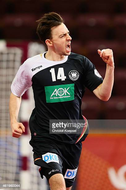 Patrick Groetzki of Germany celebrates a goal during the IHF Men's Handball World Championship group D match between Germany and Argentina at Lusail...