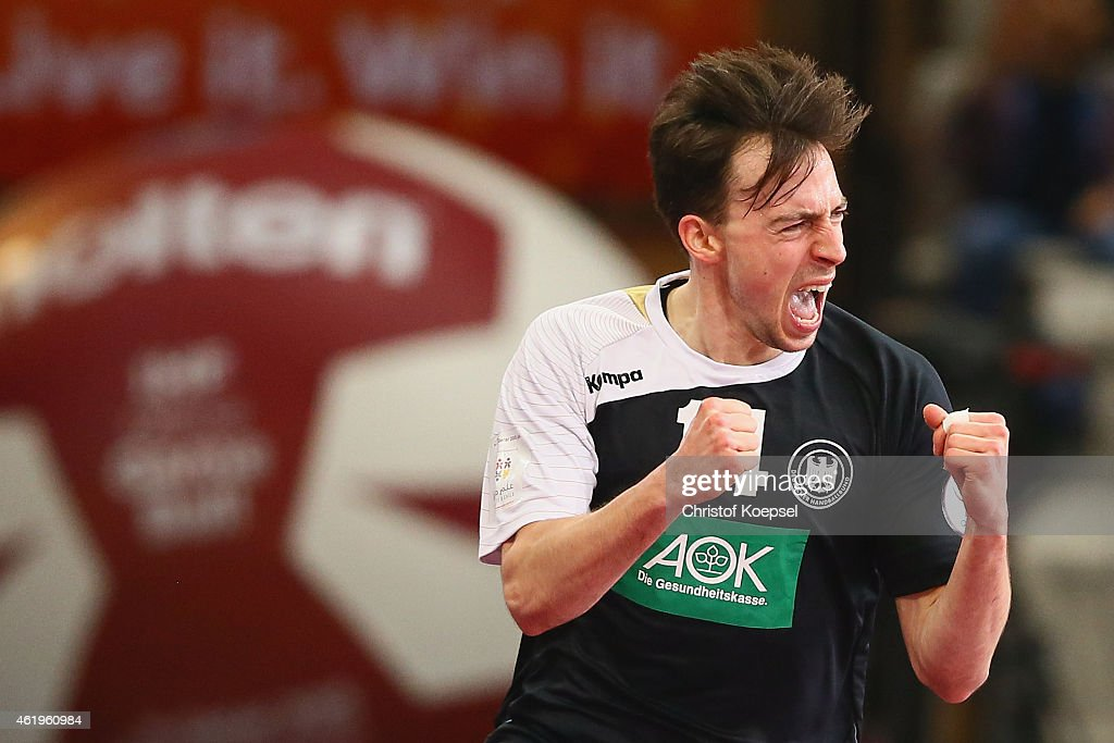 <a gi-track='captionPersonalityLinkClicked' href=/galleries/search?phrase=Patrick+Groetzki&family=editorial&specificpeople=5342990 ng-click='$event.stopPropagation()'>Patrick Groetzki</a> of Germany celebrates a goal during the IHF Men's Handball World Championship group D match between Germany and Argentina at Lusail Multipurpose Hall on January 22, 2015 in Doha, Qatar.