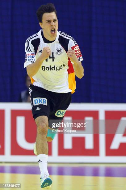 Patrick Groetzki of Germany celebrates a goal during the Men's European Handball Championship group B match between Germany and Sweden at Cair Sports...