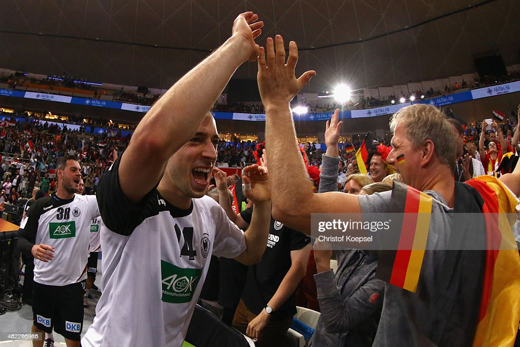 <a gi-track='captionPersonalityLinkClicked' href=/galleries/search?phrase=Patrick+Groetzki&family=editorial&specificpeople=5342990 ng-click='$event.stopPropagation()'>Patrick Groetzki</a> of Germany celebrates with the fans after the eight final match between Germany and Egypt at Lusail Multipurpose Hall on January 26, 2015 in Doha, Qatar. The match between Germany and Egypt ended 23-16.