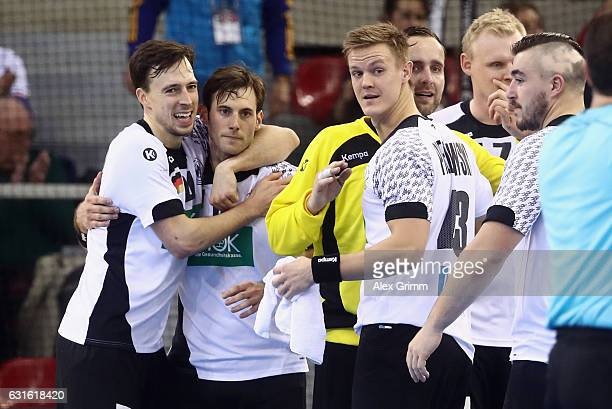 Patrick Groetzki of Germany hugs team mate Uwe Gensheimer after the 25th IHF Men's World Championship 2017 match between Germany and Hungary at...