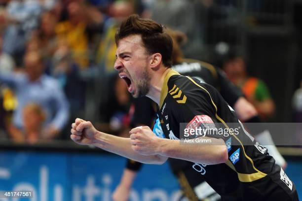 Patrick Groetzki of RheinNeckar Loewen celebrates a goal during the Velux EHF Champions League Round of 16 second leg match between RheinNeckar...