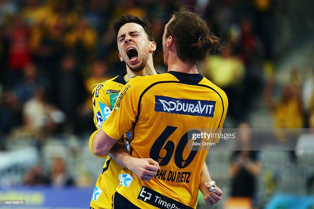 <a gi-track='captionPersonalityLinkClicked' href=/galleries/search?phrase=Patrick+Groetzki&family=editorial&specificpeople=5342990 ng-click='$event.stopPropagation()'>Patrick Groetzki</a> of Rhein-Neckar Loewen celebrates a goal with team mate Kim Ekdahl du Rietz during the DKB Handball Bundesliga match between Rhein-Neckar Loewen and HSV Hamburg at SAP Arena on May 4, 2014 in Mannheim, Germany.