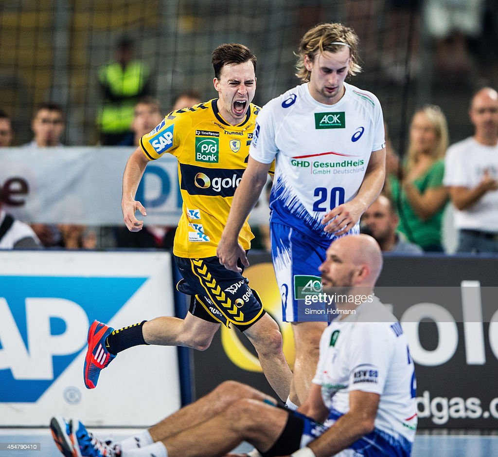 <a gi-track='captionPersonalityLinkClicked' href=/galleries/search?phrase=Patrick+Groetzki&family=editorial&specificpeople=5342990 ng-click='$event.stopPropagation()'>Patrick Groetzki</a> of Rhein-Neckar Loewen celebrates as Richard Hanisch (R) and Davor Dominikovic of Hamburg react during the DKB HBL match between Rhein-Neckar Loewen and HSV Hamburg at Commerzbank-Arena on September 6, 2014 in Frankfurt am Main, Germany.