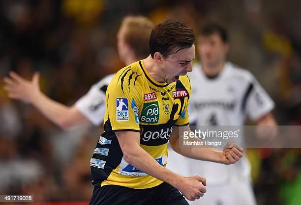 Patrick Groetzki of RheinNeckar Loewen celebrates during the DKB HBL Bundesliga match between Rhein Neckar Loewen and THW Kiel at SAP Arena on...