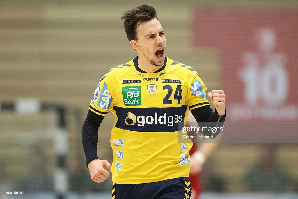 <a gi-track='captionPersonalityLinkClicked' href=/galleries/search?phrase=Patrick+Groetzki&family=editorial&specificpeople=5342990 ng-click='$event.stopPropagation()'>Patrick Groetzki</a> of Rhein-Neckar Loewen celebrates during the DKB Handball Bundesliga match between TSG Ludwigshafen-Friesenheim and Rhein-Neckar Loewen at Friedrich-Ebert-Halle on November 26, 2014 in Ludwigshafen, Germany.