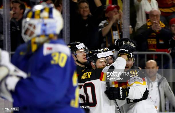 Patrick Hager of Germany celebrate with his team mates after he scores the equalizing goal during the 2017 IIHF Ice Hockey World Championship game...