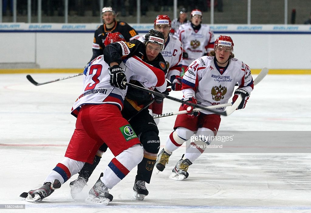 Patrick Hager of Germany challenges Maxim Berezin of Russia during the Top Teams Sochi match between Germany and Russia at Kuechwaldhalle on December 11, 2012 in Chemnitz, Germany.