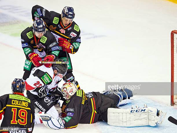 Patrick Hager of the Koelner Haien Maxi Kammerer Corey Mapses and Mathias Niederberger of the Duesseldorfer EG during the game between the...