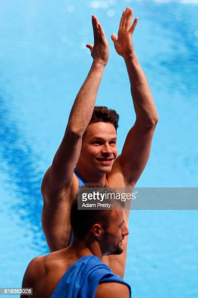 Patrick Hausding and Sascha Klein of Germany celebrate after winning the bronze medal during the Men's Diving 10M Synchro Platform final on day four...