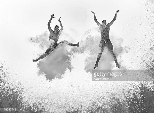 Patrick Hausding and Sascha Klein of Germany compete in the Men's 10m Platform Synchro preliminary round during Day Two of the 14th FINA World...
