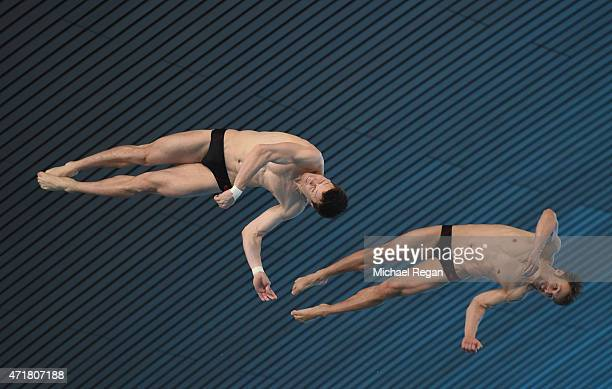 Patrick Hausding and Sascha Klein of Germany compete in the Men's Synchro Platform during the FINA/NVC Diving World Series at the Aquatics Centre on...