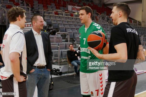 Patrick Heckmann #33 and Daniel Theis #10 of Brose Bamberg with Johannes Voigtmann #7 of Baskonia Vitoria and the national assistantcoach Henrik...