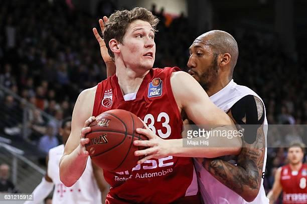 Patrick Heckmann of Brose Bamberg is challenged by Kenneth Horton of Telekom Baskets Bonn during the BBL Bundesliga match between Telekom Baskets...