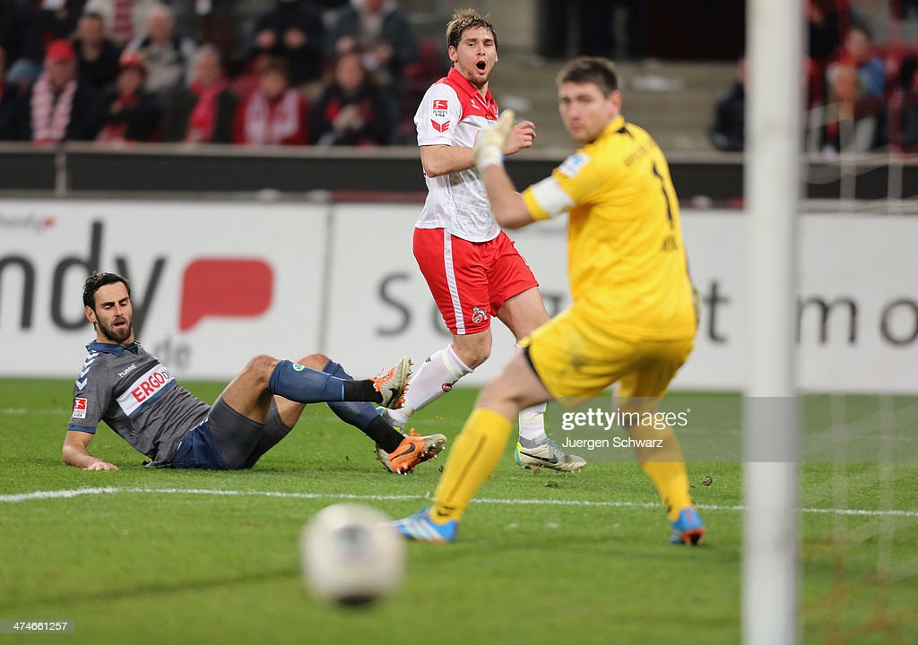 Patrick Helmes of Cologne (C) eyes the ball between Mergim Mavraj of Fuehrt (L) and Wolfgang Hesl during the 2nd Bundesliga match between 1. FC Koeln and Greuther Fuerth at RheinEnergieStadion on February 24, 2014 in Cologne, Germany.