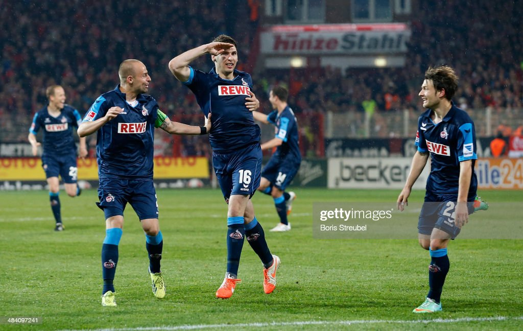 Patrick Helmes of Koeln celebrates after scoring his team's second goal by freekick with team mates during the Second Bundesliga match between 1FC...