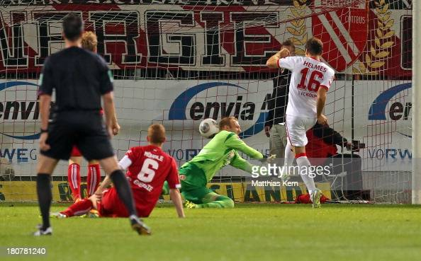 Patrick Helmes of Koeln scores the first goal during the Second Bundesliga match between FC Energie Cottbus and 1FC Koeln at Stadion der Freundschaft...