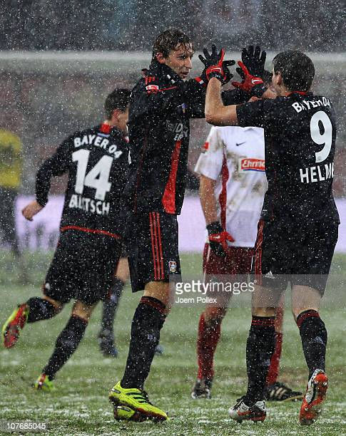 Patrick Helmes of Leverkusen celebrates with his team mate Simon Rolfes after scoring his team's second goal during the Bundesliga match between...