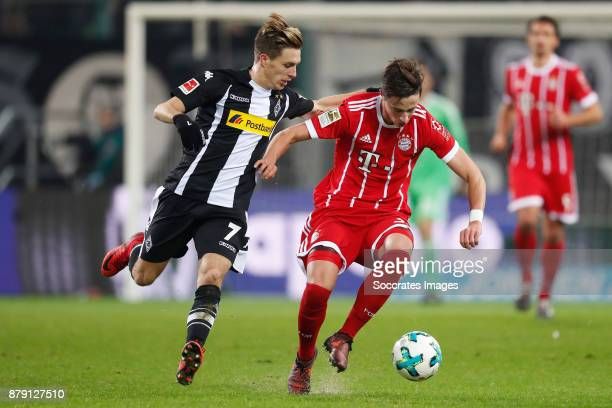 Patrick Hermann of Borussia Monchengladbach Marco Friedl of Bayern Munchen during the German Bundesliga match between Borussia Monchengladbach v...