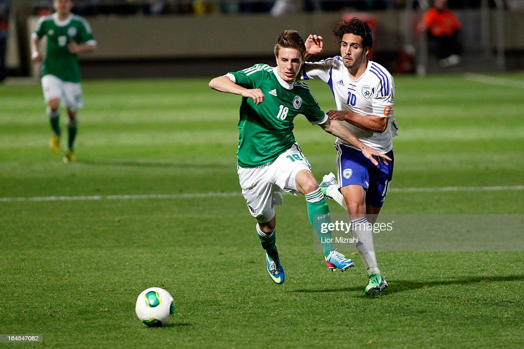 Patrick Herrman of Germany challenges Eyal Golasa of Israel during the Under 21 International Friendly match between Israel and Germany on March 24 2013 in Tel Aviv , Israel.