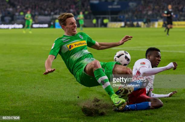 Patrick Herrmann of Borussia Moenchengladbach and Gideon Jung of Hamburger SV battle for the ball during the Bundesliga match between Hamburger SV...