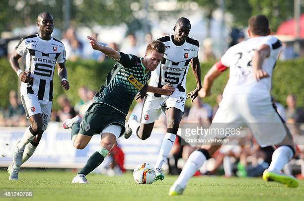 Patrick Herrmann of Borussia Moenchengladbach and Tacouba Sylla of Stade Rennes battle for the ball during the friendly match between Stade Rennes...