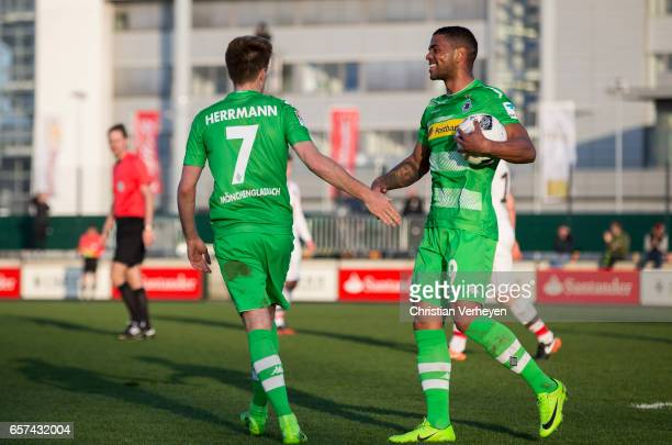 Patrick Herrmann of Borussia Moenchengladbach celebrate with Kwame Yeboah after he scores his teams fourth goal during the Friendly Match between...