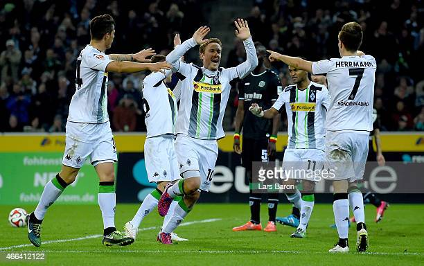 Patrick Herrmann of Borussia Moenchengladbach celebrates with Max Kruse of Borussia Moenchengladbach anfter scoring his teams second goal during the...