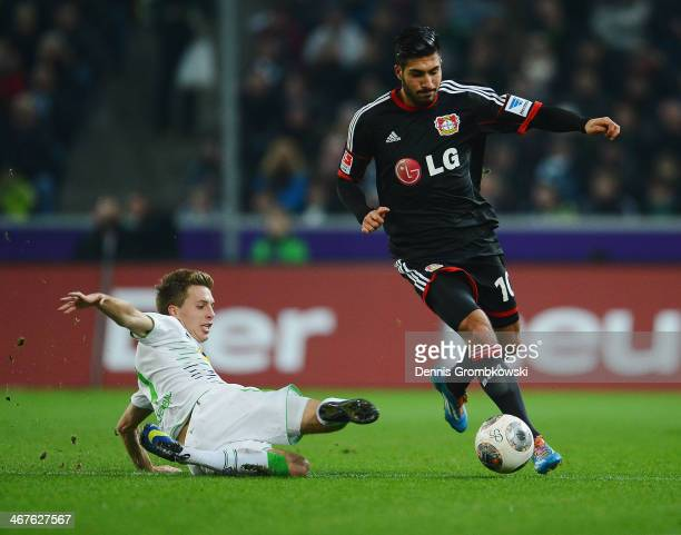PAtrick Herrmann of Borussia Moenchengladbach challenges Emre Can of Bayer Leverkusen during the Bundesliga match between Borussia Moenchengladbach...