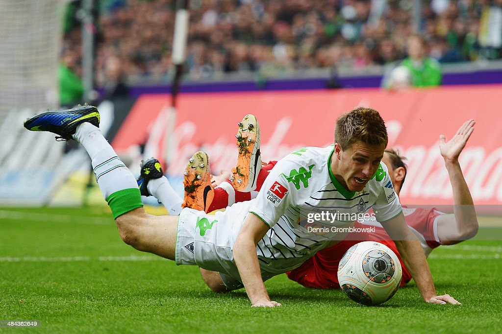 Patrick Herrmann of Borussia Moenchengladbach is challenged by <a gi-track='captionPersonalityLinkClicked' href=/galleries/search?phrase=Georg+Niedermeier&family=editorial&specificpeople=5543183 ng-click='$event.stopPropagation()'>Georg Niedermeier</a> of VfB Stuttgart during the Bundesliga match between Borussia Moenchengladbach and VfB Stuttgart at Borussia-Park on April 12, 2014 in Moenchengladbach, Germany.