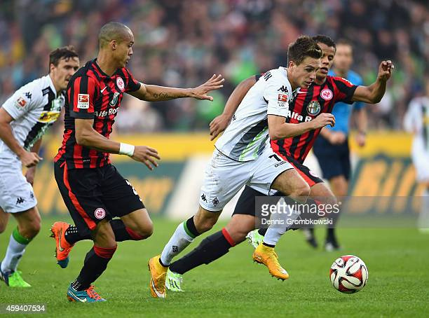 Patrick Herrmann of Borussia Moenchengladbach is chased by Timothy Chandler and Bamba Anderson of Eintracht Frankfurt during the Bundesliga match...