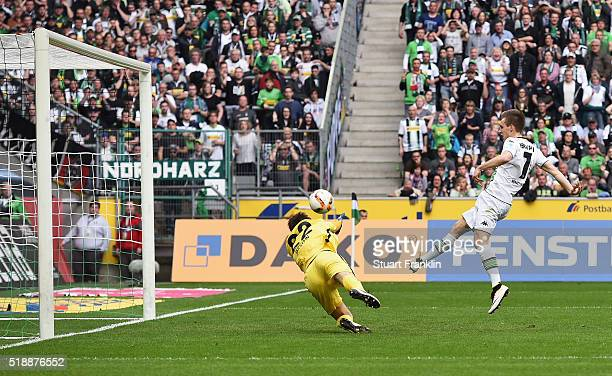 Patrick Herrmann of Borussia Moenchengladbach shoots past goalkeeper Rune Almenning Jarstein of Hertha Berlin to score their thrid goal during the...