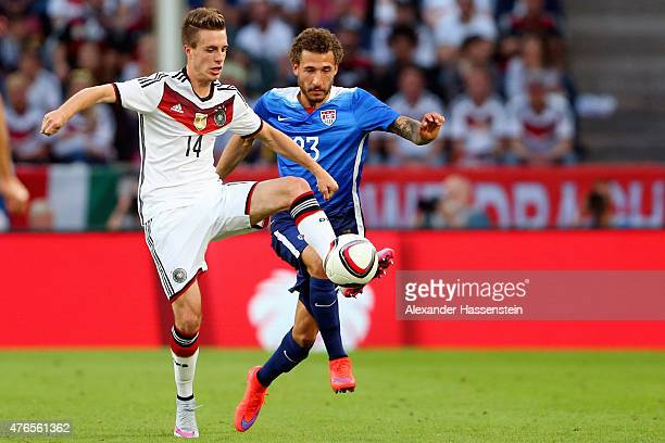 Patrick Herrmann of Germany battles for the ball with Fabian Johnson of USA during the international friendly match between Germany and USA at...